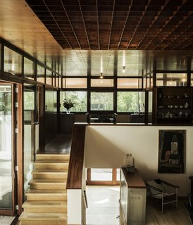 The sunken living room is illuminated by an eight-by-eight-foot gridded skylight in the copper ceiling.