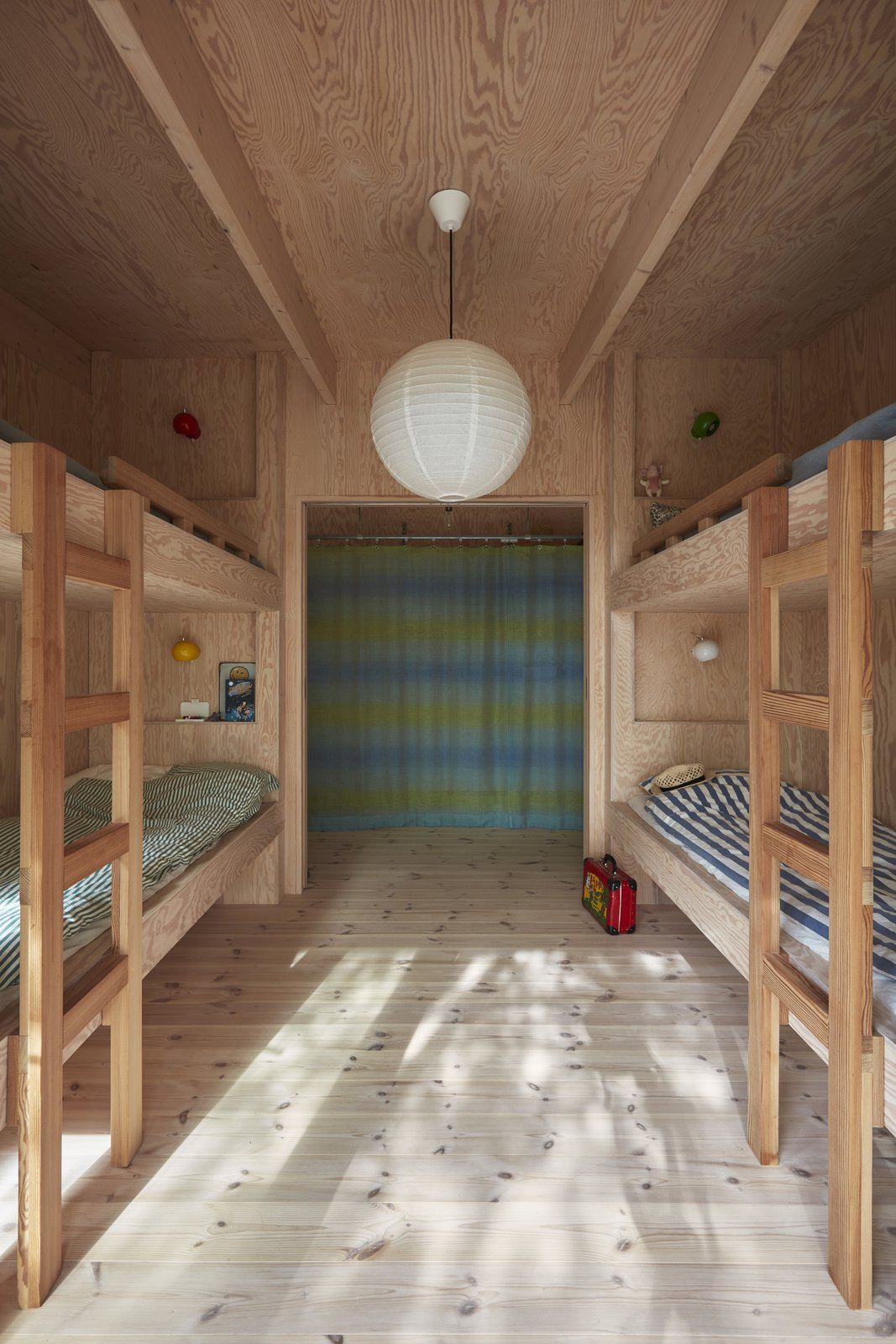 Kids, Bedroom, Bunks, Bed, Neutral, and Light Hardwood The built-in plywood bunks in the children's room were designed by STEG.  Best Kids Bunks Neutral Photos from A Pint-Sized, No-Frills Summerhouse Rises From the Rocks on a Swedish Island