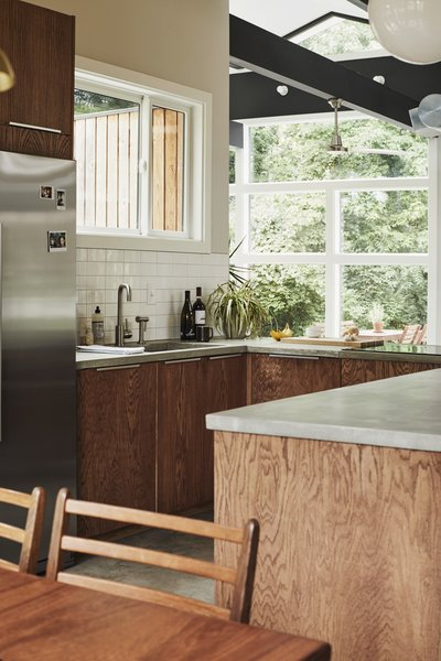 White subway tiles and a large window over the sink brighten the kitchen.