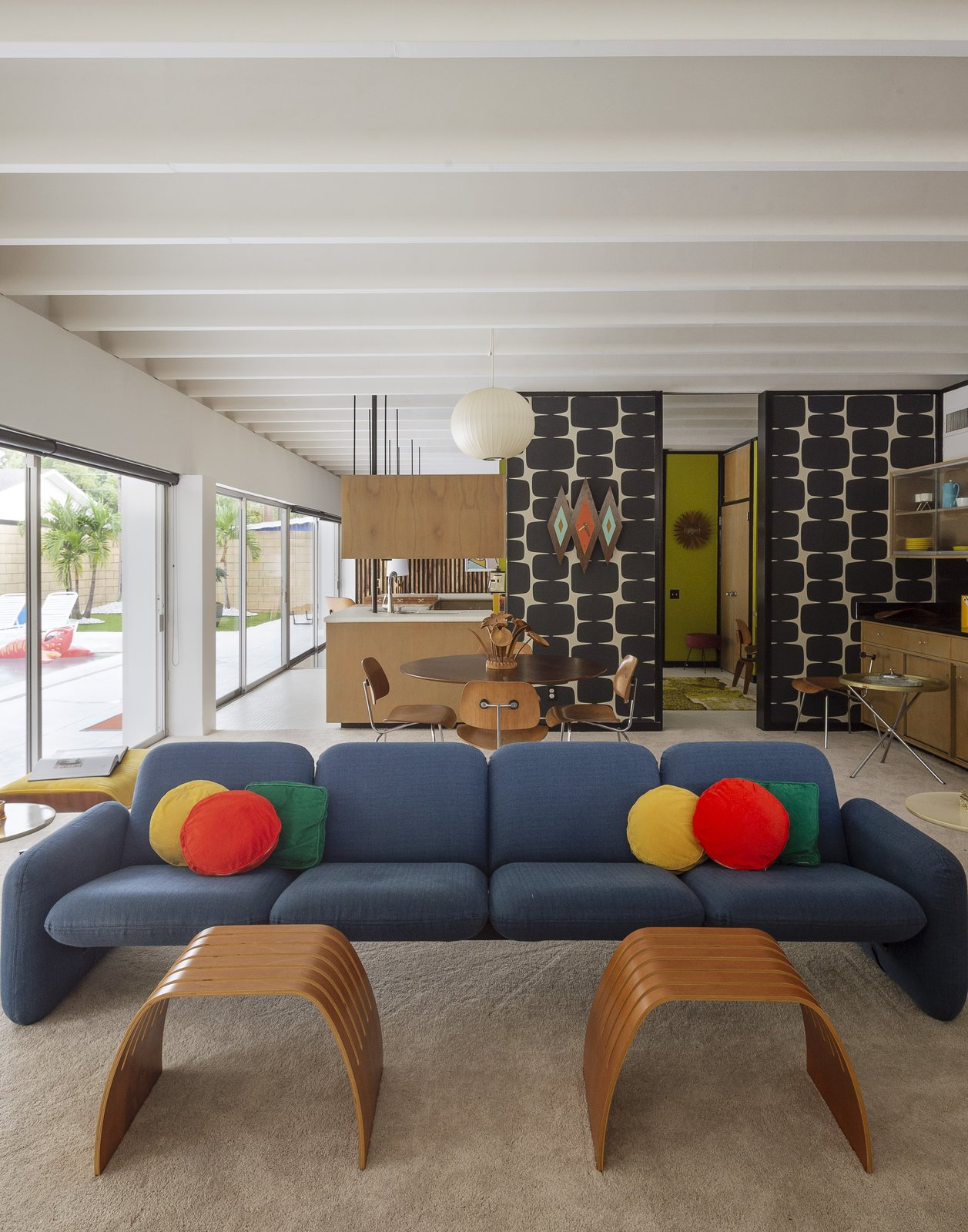 Living Room, Chair, Table, Carpet Floor, Ceiling Lighting, Coffee Tables, and Sectional The living area's Chicklet sofa by Ray Wilkes is covered in a Knoll tweed.  My Photos from Pop Art, Street Art, and Space Age Furniture Collide at a Painter's Midcentury Ranch Home in Florida