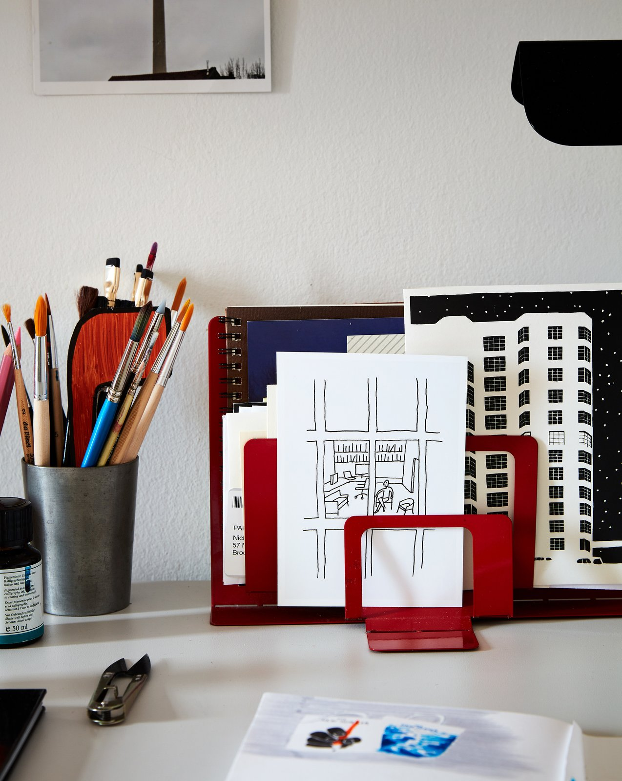 Office and Study Room Type A sketch Nicholas drew of his office at The New Yorker stands in front of an illustration he made of their building.  My Photos from Two Magazine Creatives Fit Graphic Art and Vintage Furniture In a Brooklyn Apartment
