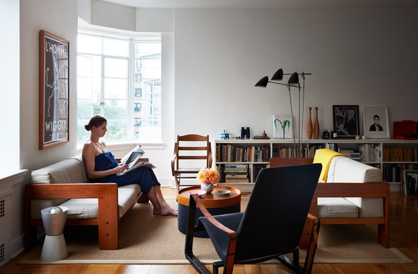 Luise Stauss, a former photo editor at The New York Times Magazine,  sits in the living room of the downtown Brooklyn apartment she shares with her husband, Nicholas Blechman, the creative director of The New Yorker. The roughly 1,000-square-foot space feels larger than it is, thanks to high ceilings and bay windows. Twin 1962 Bastiano sofas by Tobia Scarpa are joined by a Cité chair by Jean Prouvé and a wood chair acquired from the New York Historical Society. The floor lamp is by David Weeks Studio.