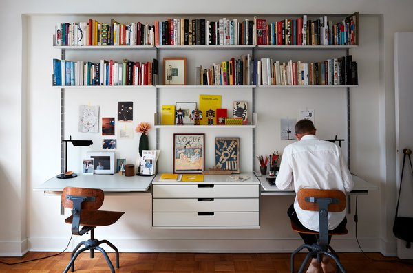 The best home office ideas for two allow ample space for both workers. At the home of Nicholas Blechman, the creative director of The New Yorker, and Luise Stauss, a photo editor and art director, the home office boasts a Vitsœ wall unit that allows each to display their favorite curios—while still providing plenty of shared space for supplies and books.