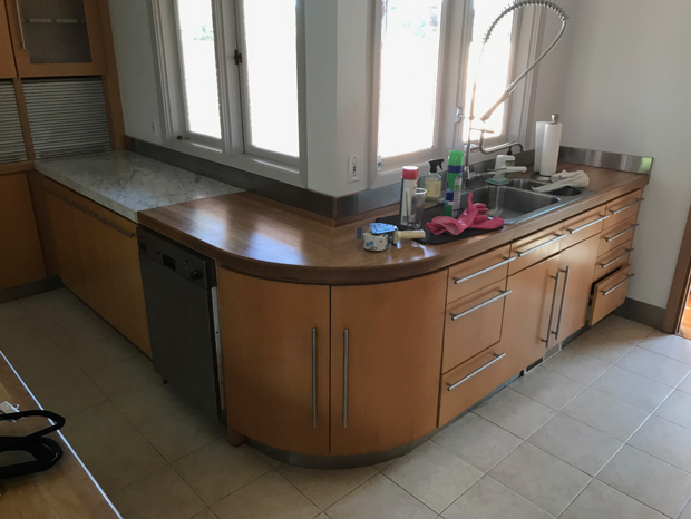 """Many of the original kitchen cabinets were kept in place, """"as they were beautifully made, and the owners loved them  Photo 7 of 21 in Before & After: A 1954 Midcentury in Portland Is Stunningly Revived"""