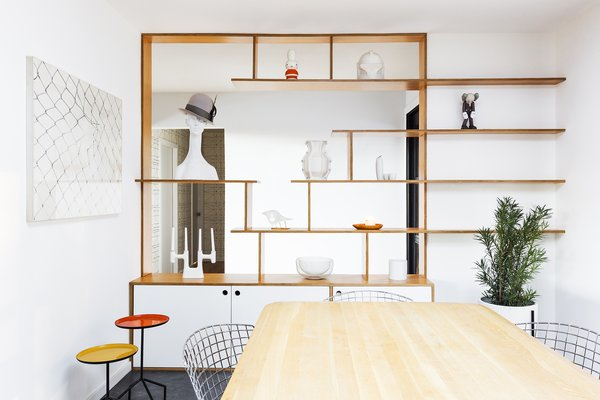 Horner replaced the closed storage with custom, open shelving that now connects to the entry, increasing natural light and sight lines throughout the house.