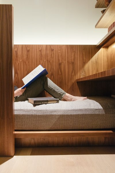 """In addition to a desk, there's a tucked-in bed for reading or relaxing. """"The idea behind the office was figuring out three tiers,"""" explains Rachel, """"rest, casual, and full-on work mode."""""""