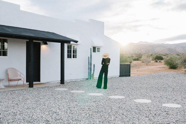 Naude and Brown took notes from legendary designers Luis Barragán, Jacques Grange, and Terence Conran for Casa Mami. Lounge chairs and the Confetti table from LAUN adorn the entry.