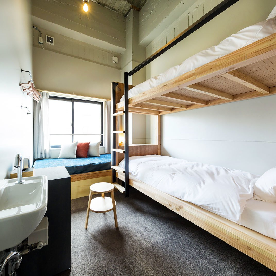 Bedroom, Bunks, Storage, Pendant Lighting, and Carpet Floor The Share Hotels Hatchi Kanazawa in Kanazawa, Japan  Photo 5 of 11 in 11 Alluring Places to Stay in Japan Under $300 a Night from The Share Hotels Hatchi Kanazawa