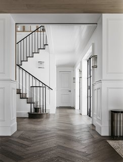 The breezy foyer exemplifies the design team's commitment to creating an airy, elegant space.