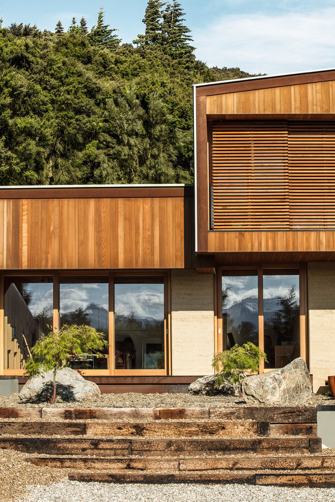 Kanuka Valley House exterior with sliding cedar screens
