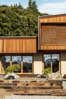 When closed, the screens blend in with the cedar siding.