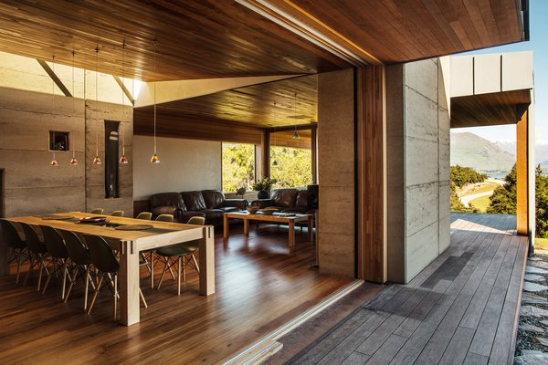 Nigel, an accomplished furniture maker, built the oak-and-yew dining table. Reclaimed rimu wood was used for ceilings and floors. The sliding glass doors are by Thermadura.
