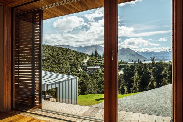 One of the home's many sliding cedar shutters opens to reveal a spectacular vista.