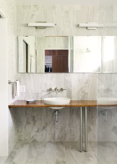 The same ceramic tiles are used in the master bathroom.