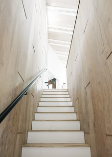 """Of the addition, which holds two bedrooms, a study, and a bathroom, Erik says, """"We wanted it to feel connected and integrated on the interior but read as a new, distinct volume on the exterior."""""""