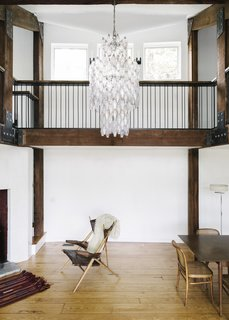 The chandelier is a family heirloom, based on a 1950s design by Carlo Scarpa.