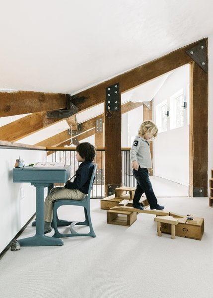 The kids play in a refurbished loft above the kitchen/dining area.