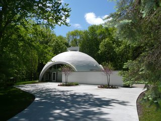 Neatly tucked in Northwest Midland, this eclectic residence was designed in the 1960s by Robert E. Schwartz, a student of Buckminster Fuller. Commonly known as the Dome Home, the shell of the house was made from a spiral-generated styrofoam constructed with Dow Chemical technology.