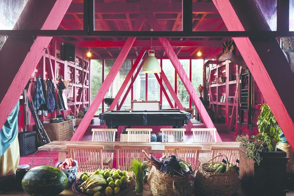 The ground floor is painted all in red—a nod to the native chilcos, or fuchsia.
