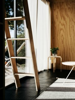At $60, the sliding track hardware for the ladder to the loft cost twice as much as it cost to make the ladder itself.