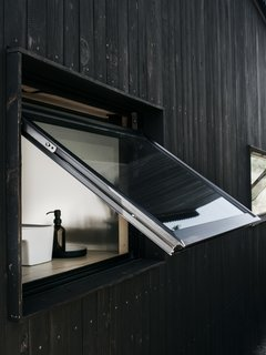 A Milgard awning window provides ventilation.