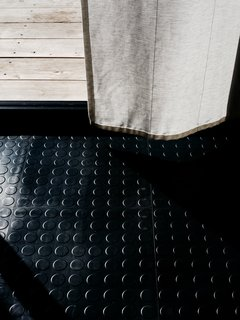 Interlocking rubber tiles from HiddenLock provide a watertight seal for the floor. Primarily used in garages, the tough, spill-friendly tiles cost about $3.15 per square foot.