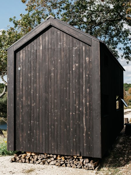 """With prices starting in the low five figures, pretreated shou sugi ban siding was out of the question. """"My girlfriend and I spent a week cutting, trimming, burning, scrubbing, and oiling the cedar ourselves,"""" says Ryan. The project cost a total of $550 in materials."""