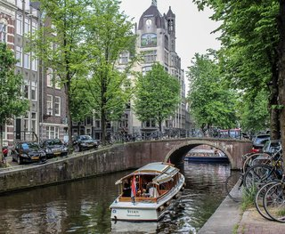 """Commonly known as the """"Venice of the North,"""" Amsterdam has 165 canals and a total of 1,281 bridges. The most prominent canals are Herengracht, Prinsengracht, Keizersgracht, and Singel."""