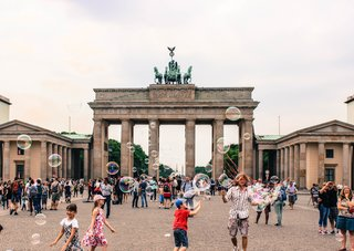 Built in the 18th century, the sandstone Brandenburg Gate is one of the earliest examples of neoclassical architecture in Germany. While it symbolized the East and West division of Germany from 1961 to 1989, this iconic monument now represents reunification.