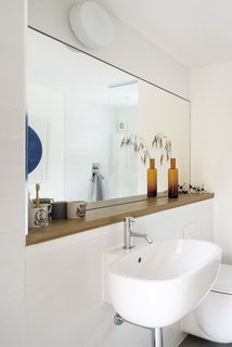 In the bathroom, a Zyam tap by Aston Matthews is mounted on a Series 500 sink by Antonio Citterio for Pozzi-Ginori.