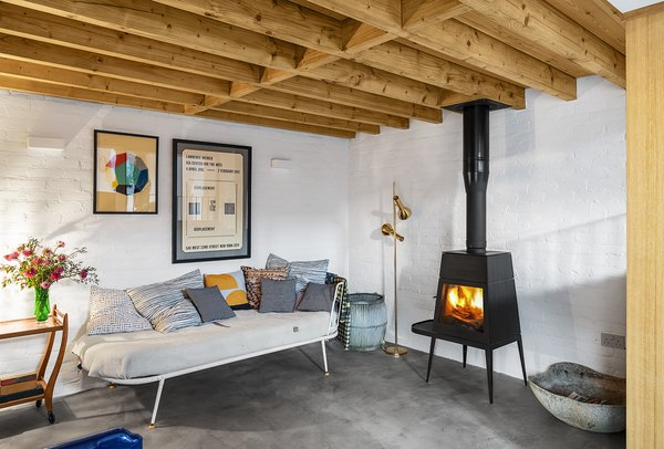 The hangout features a vintage sofa that Sandy found on eBay and a Shaker woodstove by Antonio Citterio.