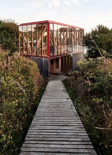 Architect Guillermo Acuña's sprawling getaway lines the coast of Isla Lebe in the Chiloé Archipelago in Chile. <span style=