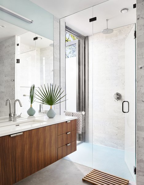 The bathroom features an indoor/outdoor shower. The Wetstyle sink is outfitted with a Blu Bathworks faucet.