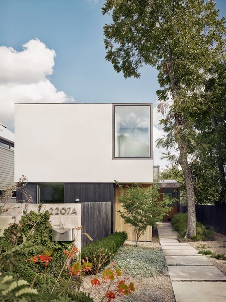 The geometrically disciplined facade is composed of blonde cypress, white stucco, and cedar that was charred black by Delta Millworks.