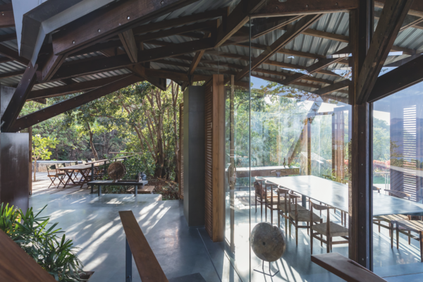 A choice of dining areas, either partially protected or enclosed with glass and light wooden louvers.