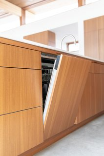 """To complement the sleek, clean aesthetic of the kitchen, Joel and Meelena heavily relied on Dacor for appliances. """"One of the great things about working with Dacor is how they transform really high-quality kitchen equipment into casework, and as an architect, that's really exciting,"""" Joel adds."""