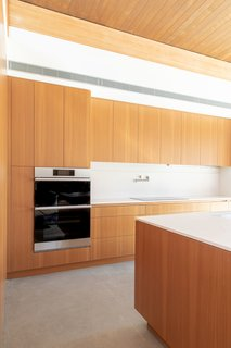 """On top of seamlessly blending into the design of the room, """"one of the great things about the microwave/oven is that it has over 150 preset cooking settings, so you can do all these things like """"healthy fry"""" and dehydrate your food, which I'm excited to start testing out,"""" Meelena adds."""