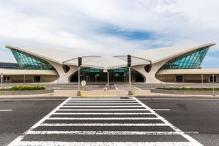 An abandoned airport terminal at New York's John F. Kennedy International Airport was reborn as the TWA Hotel, a stylish stay that harkens on the romance of flying when it was still a novelty. Paying homage to the original architecture of the 1962 building designed by architect Eero Saarinen, JFK's only on-airport hotel is complete with midcentury modern guest rooms, a 10,000-square-foot rooftop deck with pool, and immersive experiences.