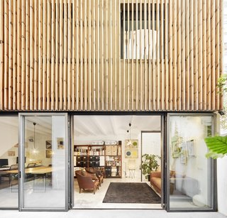 """""""It was rundown, dark, and divided,"""" recalls Masaaki of his first impression of the warehouse, the ground floor of a multistory apartment building. But after some thought, Masaaki, a Japanese-born architect, and Esther, an artist from Minorca, realized that owning the combined 2,700 square feet would allow them to headquarter Mas-aqui, the architecture and design firm they were planning to start, on-site. They bought the property and within months transformed it into a bright, modern live/work space."""