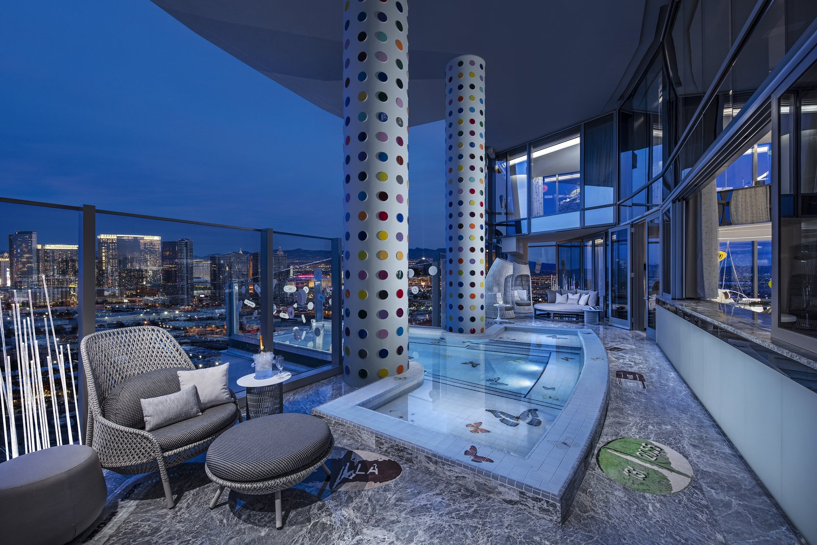 Outdoor, Small Pools, Tubs, Shower, Stone Patio, Porch, Deck, Metal Fences, Wall, Large Patio, Porch, Deck, Side Yard, and Plunge Pools, Tubs, Shower 240 signature spots cover each of the columns that frame the jacuzzi.  Photo 7 of 8 in Damien Hirst's New Suite at the Palms Casino Resort Costs $100K a Night