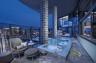 240 signature spots cover each of the columns that frame the jacuzzi.