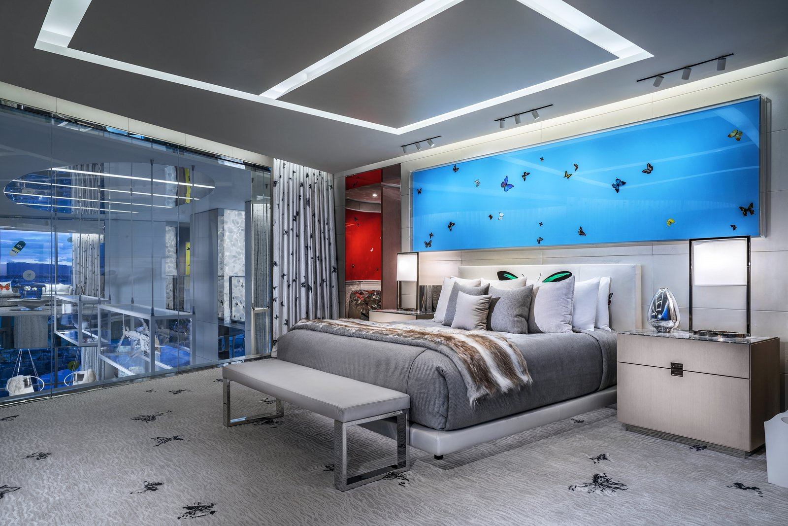 Bedroom, Carpet, Bench, Night Stands, Accent, Bed, Lamps, and Table Both bedrooms are fitted with California-king beds, sizable closets, and en-suite bathrooms.  Bedroom Carpet Accent Photos from Damien Hirst's New Suite at the Palms Casino Resort Costs $100K a Night