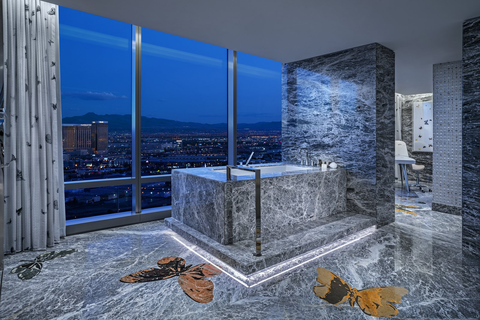 Bath, Marble, Freestanding, Marble, Marble, Undermount, and Accent Inlaid butterflies add visual interest to the vast slabs of gray marble. An adjoining massage room makes for the ultimate spa-like bathroom.  Bath Marble Accent Photos from Damien Hirst's New Suite at the Palms Casino Resort Costs $100K a Night