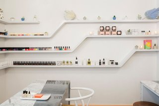 """Similarly to Chillhouse (as pictured above), Cyndi gravitates toward open-shelving to store, organize, and display her various wellness accessories in her home. """"I keep my beauty products on display via clear shelves,"""" she notes."""