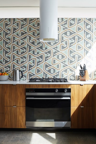 With the exception of the tk range hood, upper cabinet. TK made the walnut plywood millwork surrounding the tk oven. The mosaic tiles are from tk in Mexico City.