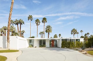 Seen today, it's hard to imagine that Jessy Moss and Steve Jocz's glistening white home in Indian Wells, California, was marketed as a teardown only two years ago. Sparing it the wrecking ball, Jessy, an interior designer who used to be a singer/songwriter, and Steve, a realtor who was once a member of the band Sum 41, embarked on a restoration. During the project, they uncovered evidence that the home might be an unrecognized work by iconic architect William F. Cody. The circular pavers in the driveway, replicas of originals, are strikingly similar to those Cody used for another midcentury motor court.