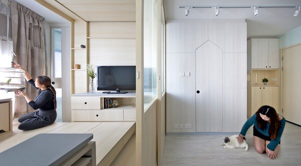 The two halves of the home can be sectioned off with sliding glass doors—one side for the parrot, and one for the cat.