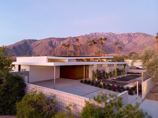A peek of the Axiom Desert House from the exterior, with the beautiful San Jacinto mountain range in the distance.