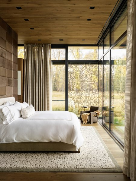 20 years after a Phoenix-bred family purchased 180 acres of wild bush, they finally decided to build upon it. They built four structures and then this modern guesthouse. The floor-to-ceiling windows throughout bring the outside world into the interior of the home.