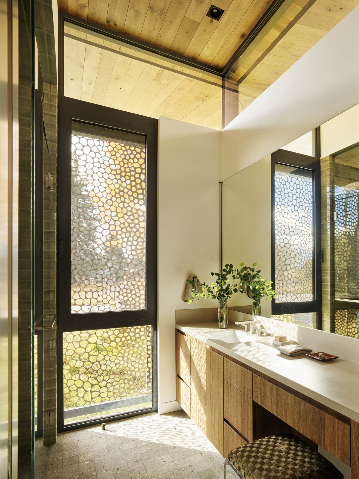 Bath Room, Undermount Sink, and Enclosed Shower Even the bathroom is enlivened by a direct connection to the outdoors.  Photo 6 of 11 in A Museum-Like Glass Pavilion Brightens a Sprawling Jackson Hole Estate